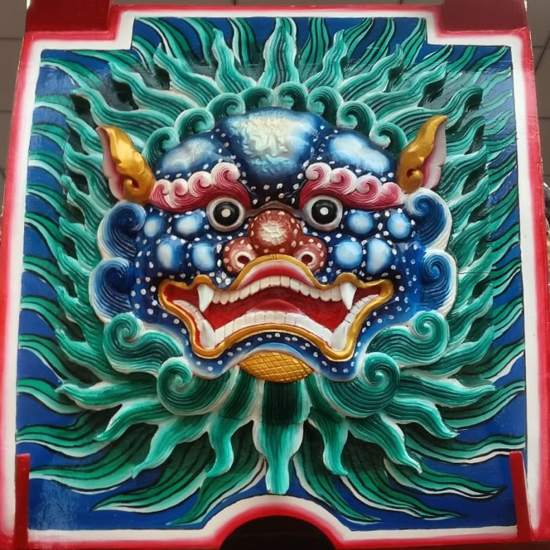 Photo of a nicely colored and carved dragon face