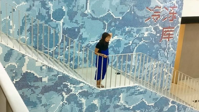 A tiled, pixel-art like wall of sea waves
