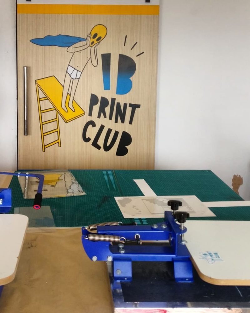 Working table plus painted sign fo the IB Print Club